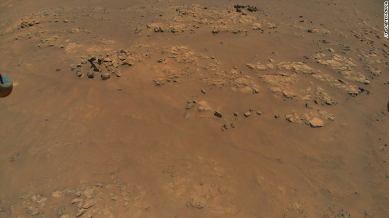 The Ingenuity helicopter is flying in parallel with the Perseverance rover as it drives on Mars -- as shown by the rover tracks captured by the chopper's camera on July 5.